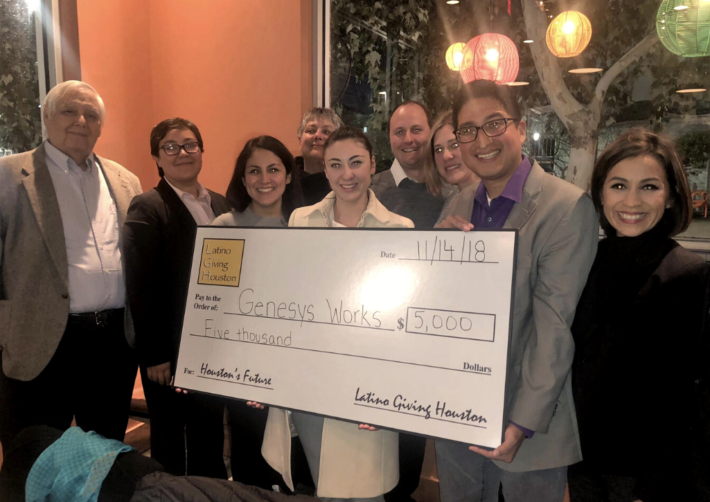 """Latinx people holding a """"big check"""" for Genesys works in the amount of $5,000 USD"""