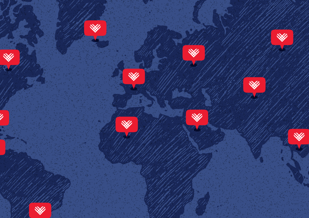 A global map with red GivingTuesday hearts pinned in various countries