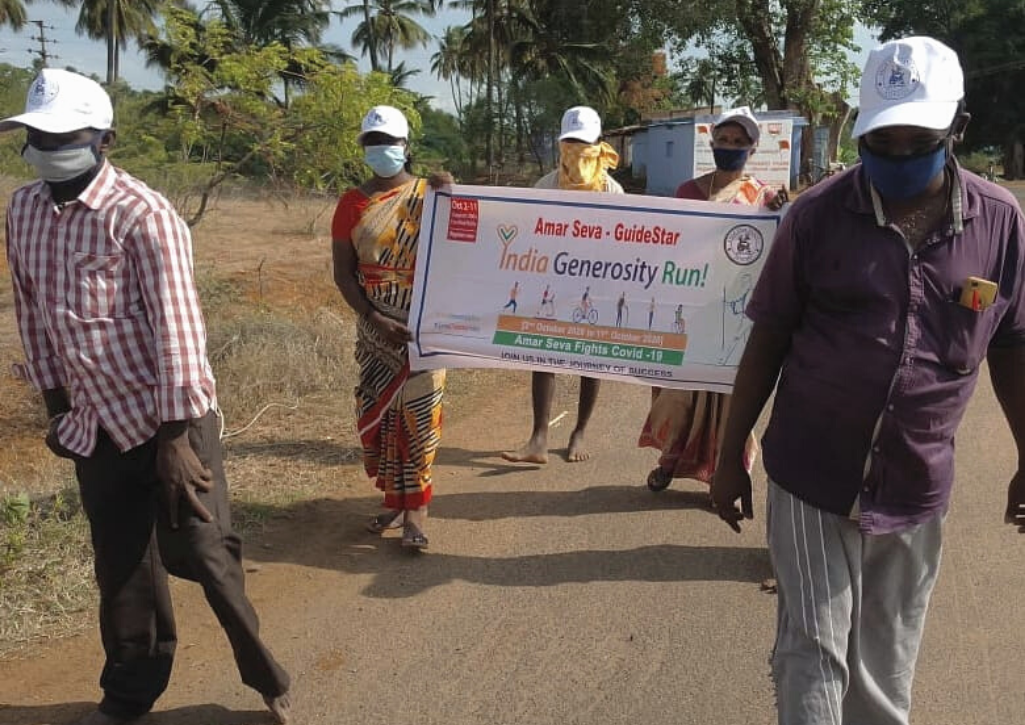 """People in India holding a sign that says """"India Generosity Run"""""""